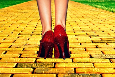 Ruby red heels standing at the start of the yellow brick road